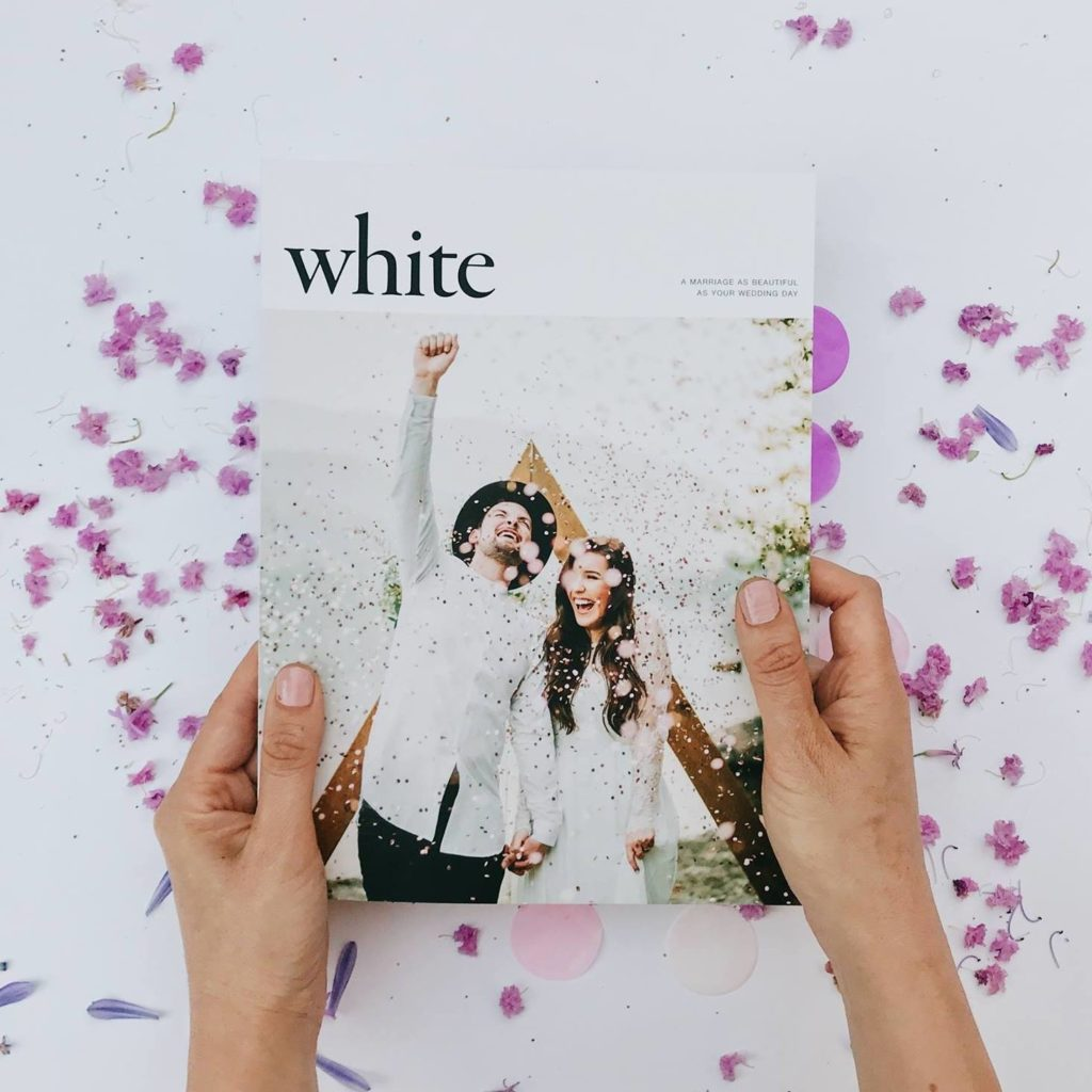 A couple are featured on the front cover of White Magazine.