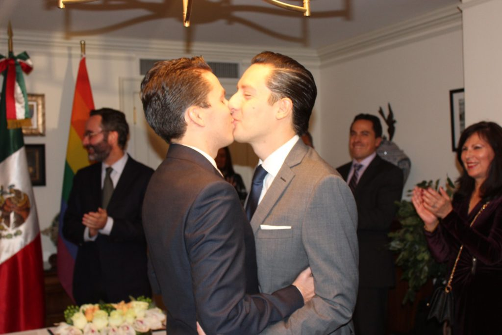 Gay Mexican couple share their first kiss after being pronounced married.