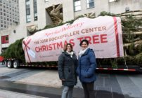 Lesbian couple Shirley Figueroa and Lissette Gutierrez pose with the Rockefeller Center tree they donated.