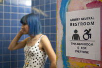 Stock photo of a transgender person in a bathroom