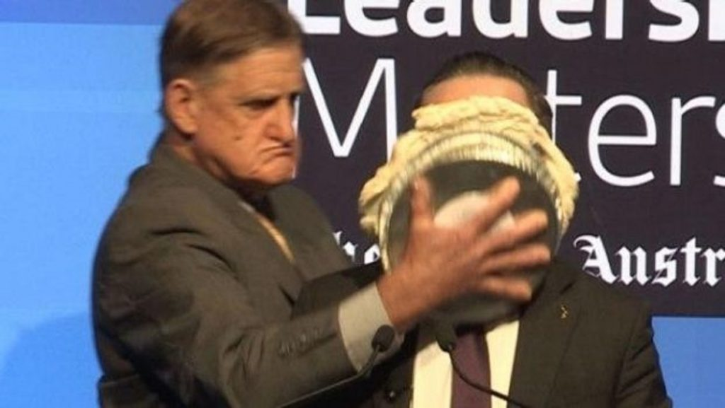 An evangelical who opposes marriage equality attacks gay CEO Alan Joyce with a pie
