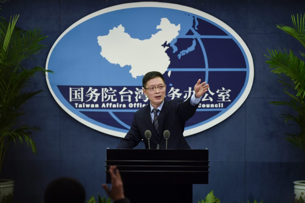 An Fengshan, spokesman for the State Council's Taiwan Affairs Office, gestures toward the media at a press conference in Beijing on December 28, 2016.