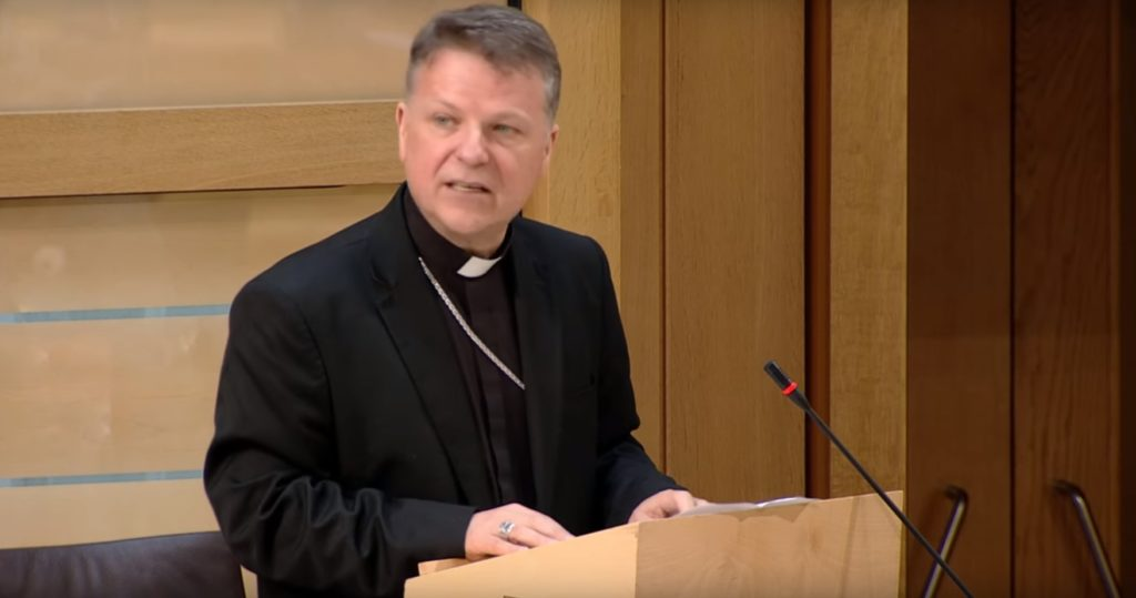Bishop John Keenan, head of the Diocese of Paisley in Scotland, addresses the Scottish Parliament