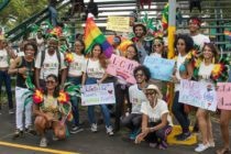 LGBT+ right activists at Guyana Pride holding up signs