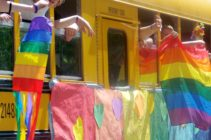 A Gay-Straight Alliance school bus takes part in a Pride parade