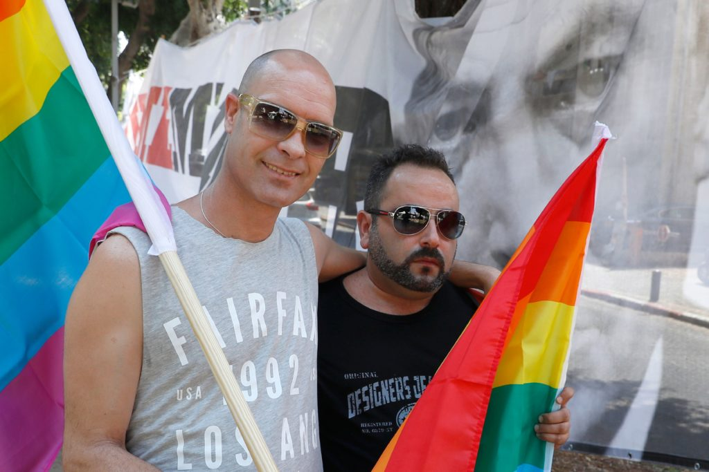 Israeli protesters attend a rally in Tel Aviv on July 22, 2018, to protest against a law on surrogacy parenthood that excludes gay parents.