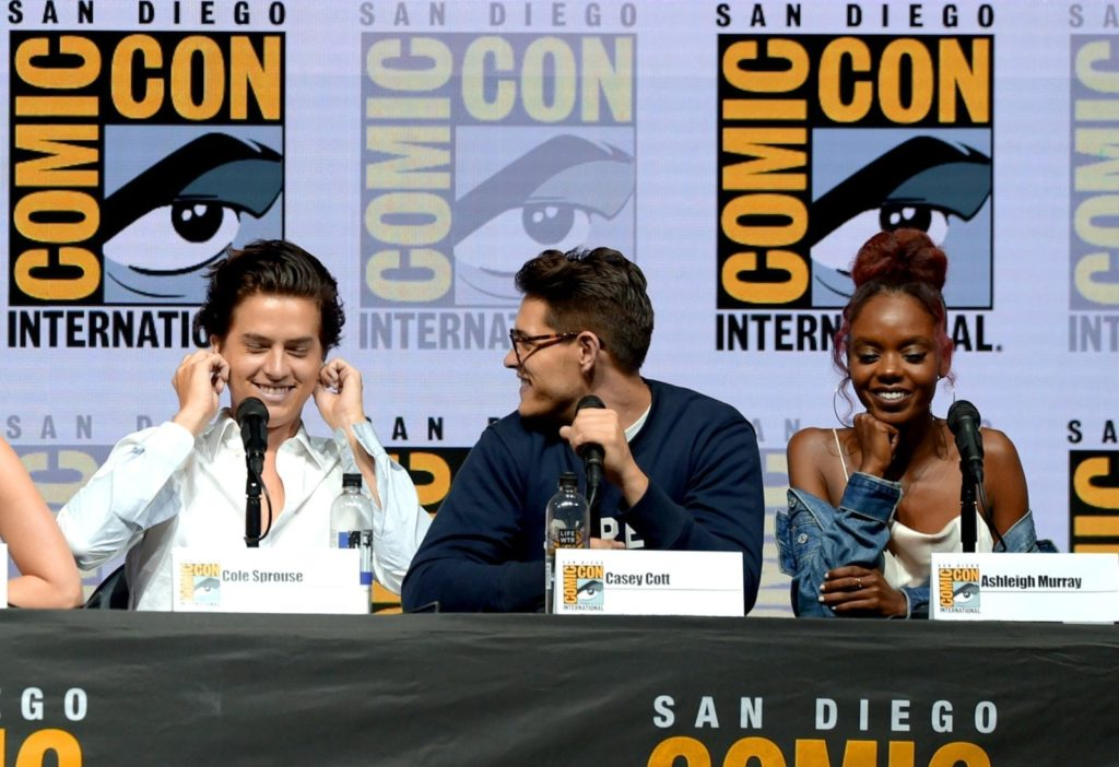 """SAN DIEGO, CA - JULY 22: (L-R) Cole Sprouse, Casey Cott and Ashleigh Murray speak onstage at the """"Riverdale"""" special video presentation and Q&A during Comic-Con International 2018 at San Diego Convention Center on July 22, 2018 in San Diego, California. (Photo by Kevin Winter/Getty Images)"""