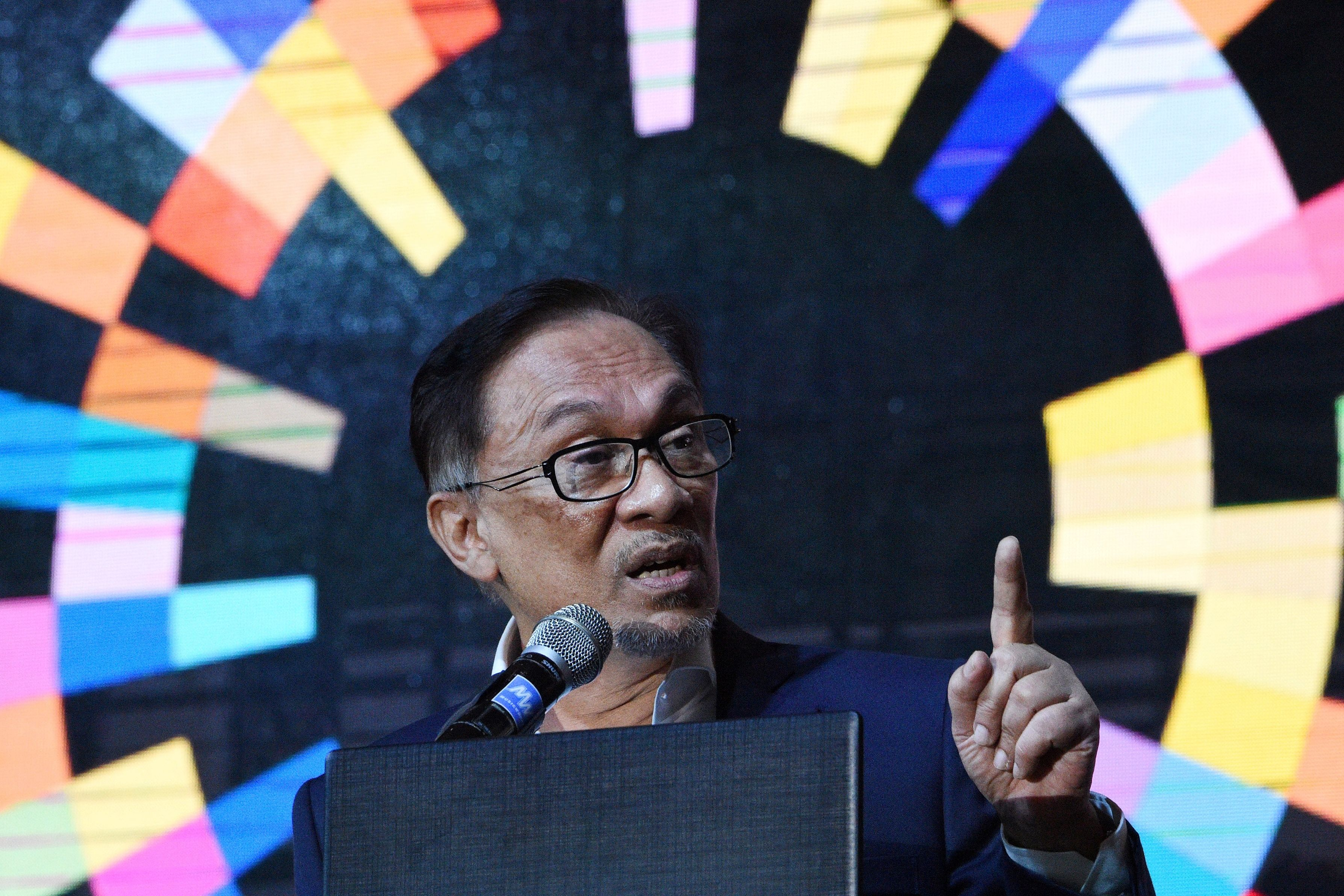 Malaysia's former deputy prime minister Anwar Ibrahim delivers a speech during a CEO conference organised by a local management association in Manila on September 4, 2018. - Anwar was jailed in 2015 on sodomy charges that critics say were politically motivated and then released in May 2018 after then-Prime Minister Najib Razak's election defeat. (Photo by TED ALJIBE / AFP) (Photo credit should read TED ALJIBE/AFP/Getty Images)