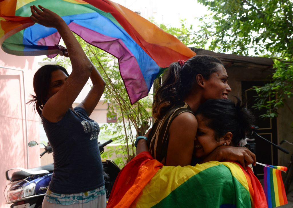 "Indian members and supporters of the lesbian, gay, bisexual, transgender (LGBT) community celebrate the Supreme Court decision to strike down a colonial-era ban on gay sex, in Chennai on September 6, 2018. - India's Supreme Court on September 6 struck down the ban that has been at the centre of years of legal battles. ""The law had become a weapon for harassment for the LGBT community,"" Chief Justice Dipak Misra said as he announced the landmark verdict. (Photo by ARUN SANKAR / AFP) (Photo credit should read ARUN SANKAR/AFP/Getty Images)"