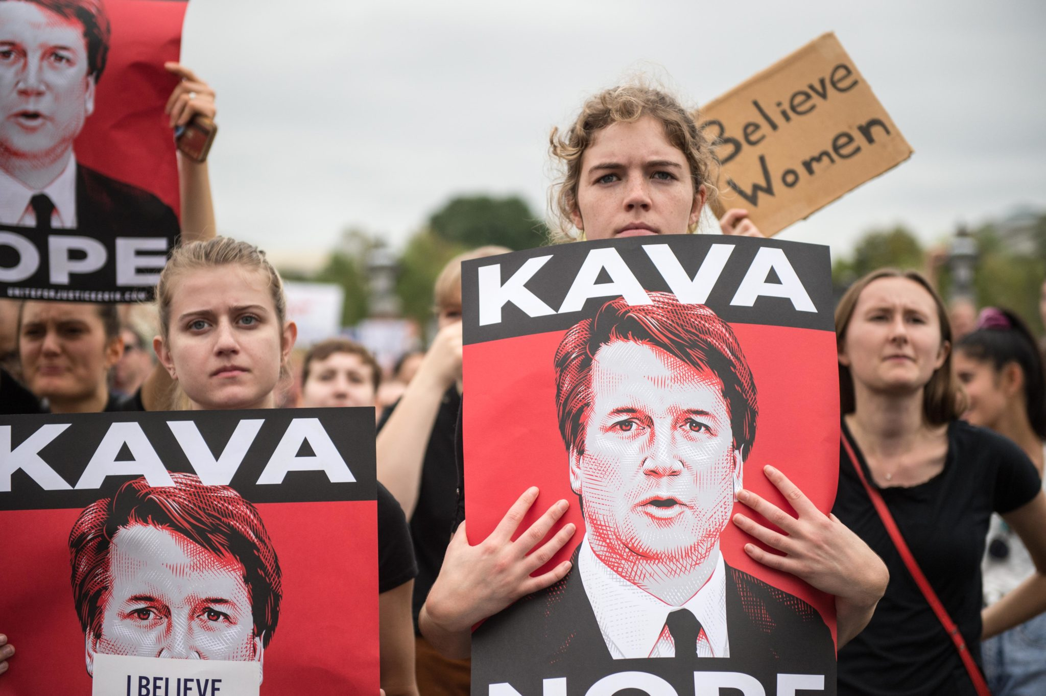 TOPSHOT - Women demonstrators protest against the appointment of Supreme Court nominee Brett Kavanaugh at the US Capitol in Washington DC, on October 6, 2018. - The US Senate confirmed conservative judge Kavanaugh as the next Supreme Court justice on October 6, offering US President Donald Trump a big political win and tilting the nation's high court decidedly to the right. (Photo by ROBERTO SCHMIDT / AFP) (Photo credit should read ROBERTO SCHMIDT/AFP/Getty Images)