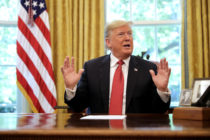 "WASHINGTON, DC - OCTOBER 17: U.S. President Donald Trump talks to reporters while hosting workers and members of his cabinet for a meeting in the Oval Office at the White House October 17, 2018 in Washington, DC. The White House said the meeting was on ""Cutting the Red Tape, Unleashing Economic Freedom."" (Photo by Chip Somodevilla/Getty Images)"