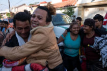 LGBT asylum seekers celebrate their arrival at the US-Mexico border.