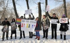 Gay-rights activists hold placards on February 14, 2011 during a rally against homophobia in Minsk. Gay rights activists said they held their first authorized action in Minsk. AFP PHOTO / VIKTOR DRACHEV (Photo credit should read VIKTOR DRACHEV/AFP/Getty Images)