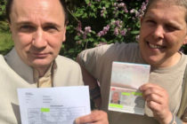 Intersex activist Alex Jurgen (R) receives Austria's first-ever documents recognising a third gender option.