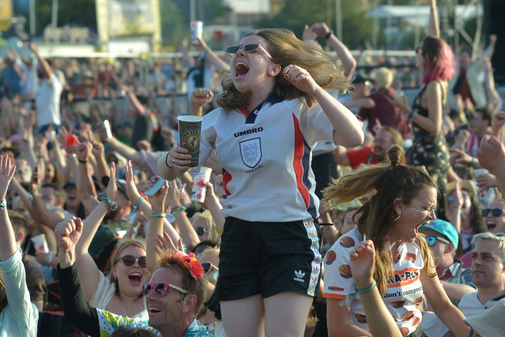 Lesbian football fan Beth Miles celebrates at the Women's World Cup screening