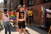 People gather outside Stonewall Inn for rally.