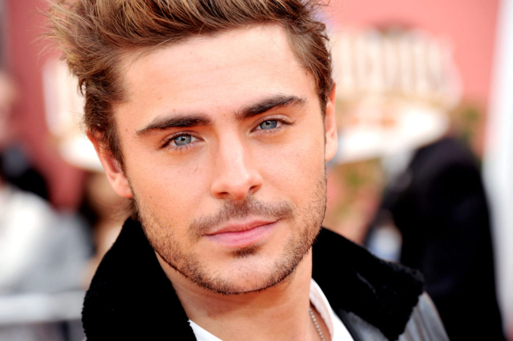 Zac Efron, who had a gay kiss with the Rock in a movie scene