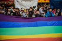 Participants carry a large flag as they take part in a Gay Pride procession in Hong Kong on November 10, 2012. As anti-discrimination laws continues to expand globally, the participant marched to promote equal rights for lesbian, gay, bisexual and transgender (LGBT). AFP PHOTO / Philippe Lopez (Photo credit should read PHILIPPE LOPEZ/AFP/Getty Images)
