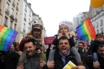 PARIS, FRANCE - DECEMBER 16: People demonstrate for the legalisation of gay marriage and parenting on December 16, 2012 in Paris, France. Demonstrations have shown a deep division in French society over the marriage equality bill expected to be passed in early 2013. The bill would not only legalize same-sex marriage but would also allow gay couples to adopt, which is seen as the most controversial issue. French President Francois Hollande, who has supported the legislation, is facing criticism from anti-gay and religious groups, while gay rights groups have warned of inadequacies within the bill. (Photo by Antoine Antoniol/Getty Images)