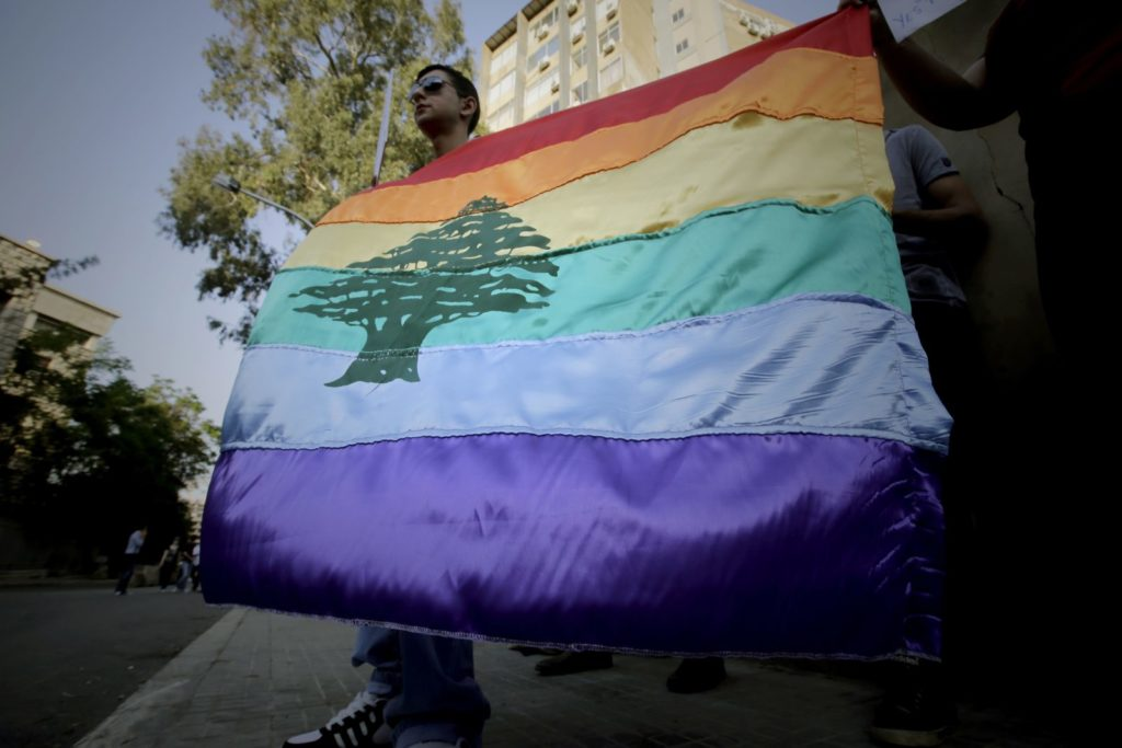 "A gay pride flag bearing the cedar tree in the middle of it is carried by human rights activists during an anti-homophobia rally in Beirut on April 30, 2013. Lebanese homosexuals, human rights activists and members from the NGO Helem (the Arabic acronym of ""Lebanese Protection for Lesbians, Gays, Bisexuals and Transgenders"") rallied to condemn the arrest on the weekend of three gay men and one transgender civilian in the town of Dekwaneh east of Beirut at a nightclub who were allegedly verbally and sexually harassed at the municipality headquarters. AFP PHOTO/JOSEPH EID / AFP PHOTO / Joseph EID (Photo credit should read JOSEPH EID/AFP/Getty Images)"