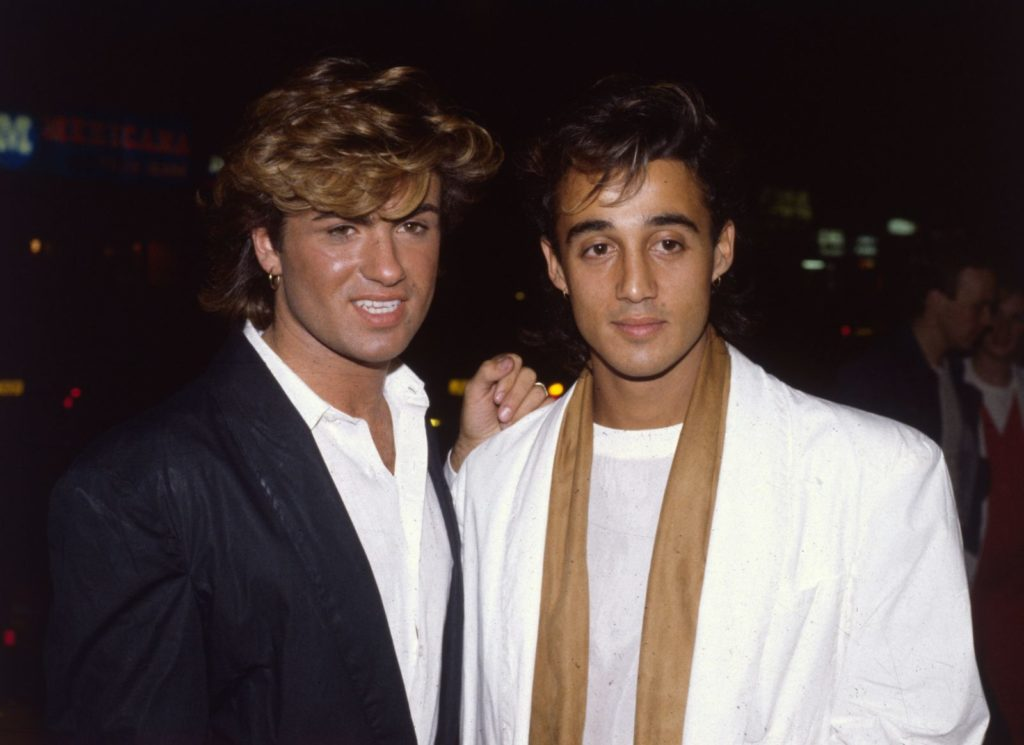 1984: British singer songwriter George Michael, lead singer of the pop group Wham!, with the group's guitarist Andrew Ridgeley at the film premiere of the hit 'Dune'. (Photo by Hulton Archive/Getty Images)
