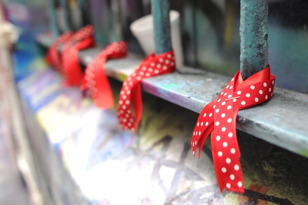 Red ribbons, a symbol of solidarity for people living with HIV/AIDS