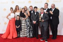 """LOS ANGELES, CA - AUGUST 25: Actresses Sarah Hyland, Sof?a Vergara, Aubrey Anderson-Emmons, Julie Bowen and Ariel Winter, Jesse Tyler Ferguson, Nolan Gould, Rico Rodriguez, Eric Stonestreet and Ed O'Neill, winners of the Outstanding Comedy Series Award for """"Modern Family"""" pose in the press room during the 66th Annual Primetime Emmy Awards held at Nokia Theatre L.A. Live on August 25, 2014 in Los Angeles, California. (Photo by Jason Merritt/Getty Images)"""