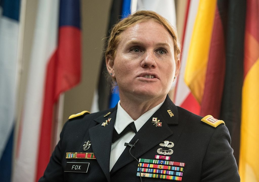 "Transgender US Army Reseve Captain Sage Fox speaks during a conference entitled ""Perspectives on Transgender Military Service from Around the Globe"" organized by the American Civil Liberties Union (ACLU) and the Palm Center in Washington on October 20, 2014. Transgender military personnel from 18 countries who allow them to serve openly, gathered to talk about their experiences and discuss whether the US military could join them. After Separtating from the military as a man, Fox legally changed her gender, and was invited to join the reserves as a woman. AFP PHOTO/Nicholas KAMM (Photo credit should read NICHOLAS KAMM/AFP/Getty Images)"