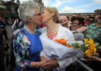 Irish Senator Katherine Zappone kisses her partner Ann Louise Gilligan following the same-sex marriage referendum in Ireland