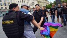Russian riot policemen detain a gay and LGBT rights activist during an unauthorized gay rights activists rally in central Moscow on May 30, 2015. Moscow city authorities turned down demands for a gay rights rally. AFP PHOTO/DMITRY SEREBRYAKOV (Photo credit should read DMITRY SEREBRYAKOV/AFP/Getty Images)