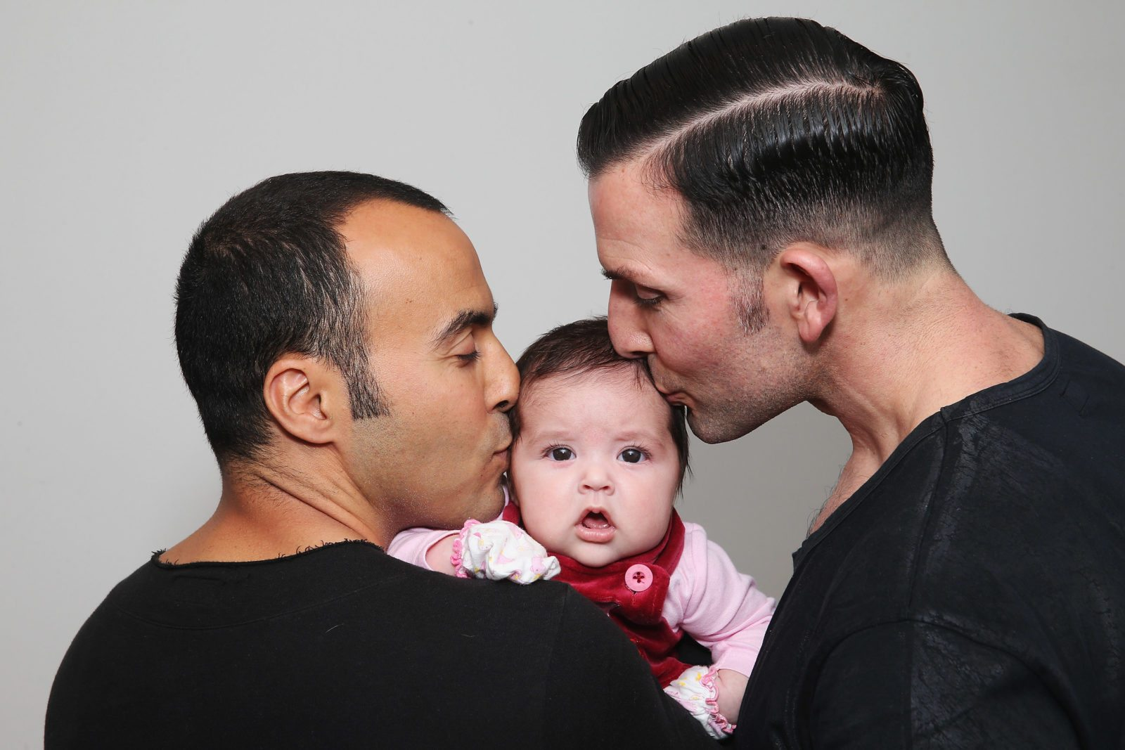 "SYDNEY, AUSTRALIA - MAY 30: (L-R) Sydney couple, Faycal Dow, aged 38, daughter Myla Dow, aged 2 months, and Hunter Dow, aged 44, pose during a portrait session on May 30, 2015 in Sydney, Australia. Faycal and Hunter were legally married in France last year and had their first child Myla this year and are supporters of same-sex marriage. "" For the sake of our daughter more than anything, it is important that our marriage is recognised as valid in Australia, the country we live in and hope to bring our beautiful daughter up in"", said Hunter. The marriage equality debate in Australia has reignited on the back of Ireland's referendum legalising same-sex marriage last week. Recent polls suggest public support for gay marriage in Australia is at an all-time high of 72%. (Photo by Don Arnold/Getty Images)"