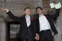 LONDON, ENGLAND - MARCH 29: Gay couple Peter McGraith and David Cabreza leave Islington Town Hall after being married shortly after midnight in one of the UK's first same-sex weddings on March 29, 2014 in London, England. Same sex couples have been able to enter into 'civil partnerships' since 2005, however following a change in the law in July 2013 gay couples are now eligible to marry in England and Wales. A number of gay couples have arranged for their wedding ceremonies to take place shortly after midnight on March 29, 2014 to become some of the first to take advantage of the new law. Parliament's decision to grant same sex couples an equal right to marriage has been met with opposition from religious groups. Gay marriage is currently being debated in Scotland, however the Northern Ireland administration has no plans to make it law. (Photo by Rob Stothard/Getty Images)