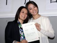 "Japanese lesbian couple Hiroko Masuhara (L) and Koyuki Higashi display a certification paper of ""partnership"" after receiving it at the Shibuya ward office in Tokyo on November 5, 2015. While the certificates are not legally binding, the district hoped they would encourage hospitals and landlords to ensure same-sex couples receive similar treatment to married people. AFP PHOTO / Yoshikazu TSUNO (Photo credit should read YOSHIKAZU TSUNO/AFP/Getty Images)"