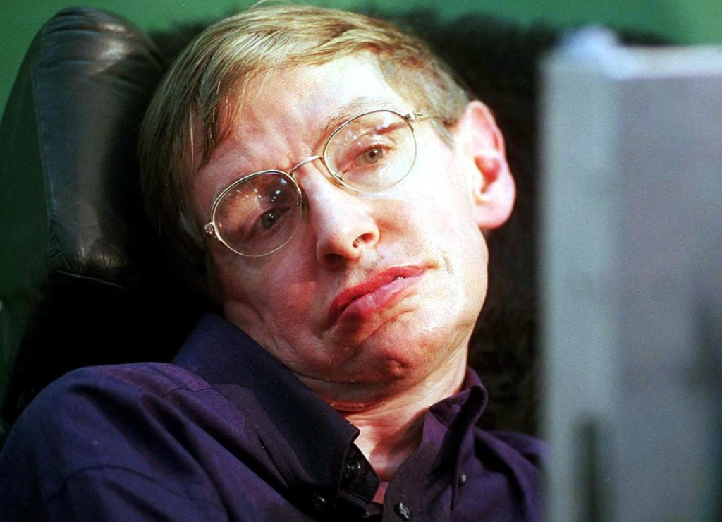 "BOMBAY, INDIA: World-renowned physicist Stephen Hawking answers questions with the help of a voice synthesiser during a press conference at the Tata Institute of Fundamental Research (TIFR) in Bombay, 06 January 2001. Hawking, along with over 300 physicists from across the world, will be attending a conference in String Theory called ""String 2001"". (FILM) AFP PHOTO (Photo credit should read STR/AFP/Getty Images)"