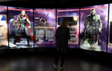 "A visitor looks at a display on Marvel Comics superhero ""Thor"" (L) and character ""Loki"" at the interactive Marvel Avengers STATION exhibition in the bussines district of La Defense, west of Paris, on April 13, 2016. / AFP / MIGUEL MEDINA / RESTRICTED TO EDITORIAL USE - MANDATORY MENTION OF THE ARTIST UPON PUBLICATION - TO ILLUSTRATE THE EVENT AS SPECIFIED IN THE CAPTION (Photo credit should read MIGUEL MEDINA/AFP/Getty Images)"