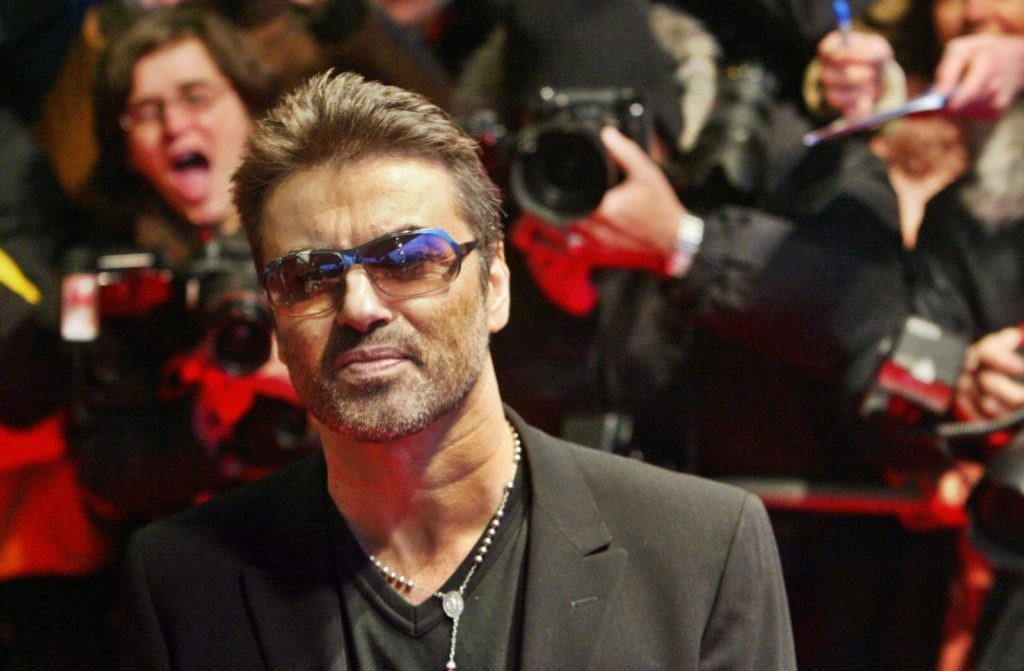 "BERLIN, Germany: British pop star George Michael poses as he walks over the red carpet prior the screening of ""George Michael - A Different Story"" at the Berlin Film Festival 16 February 2005. The film, directed by Southan Morris and presented out of competition, is a documentary featuring the life, career and politics of the iconic pop star. AFP PHOTO DDP/MICHAEL KAPPELER GERMANY OUT (Photo credit should read MICHAEL KAPPELER/AFP/Getty Images)"