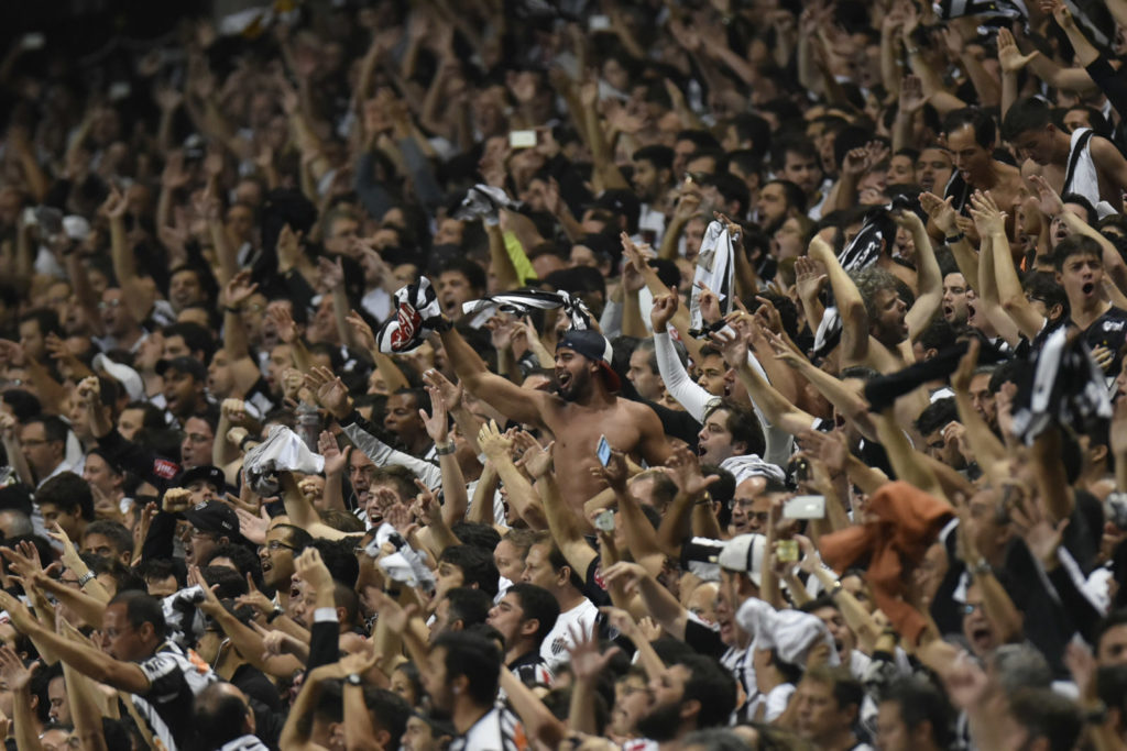 Fans of Brazil's Atletico Mineiro cheer for their team during their 2016 Libertadores Cup match against Argentina's Racing at the Independencia Stadium in Belo Horizonte, Brazil on May 4, 2016. / AFP / DOUGLAS MAGNO (Photo credit should read DOUGLAS MAGNO/AFP/Getty Images)