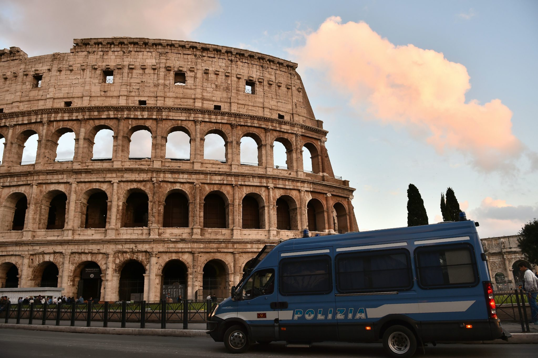 This photo taken on May 12, 2016 in Rome shows an Italian police van stationed outside of the Colosseum
