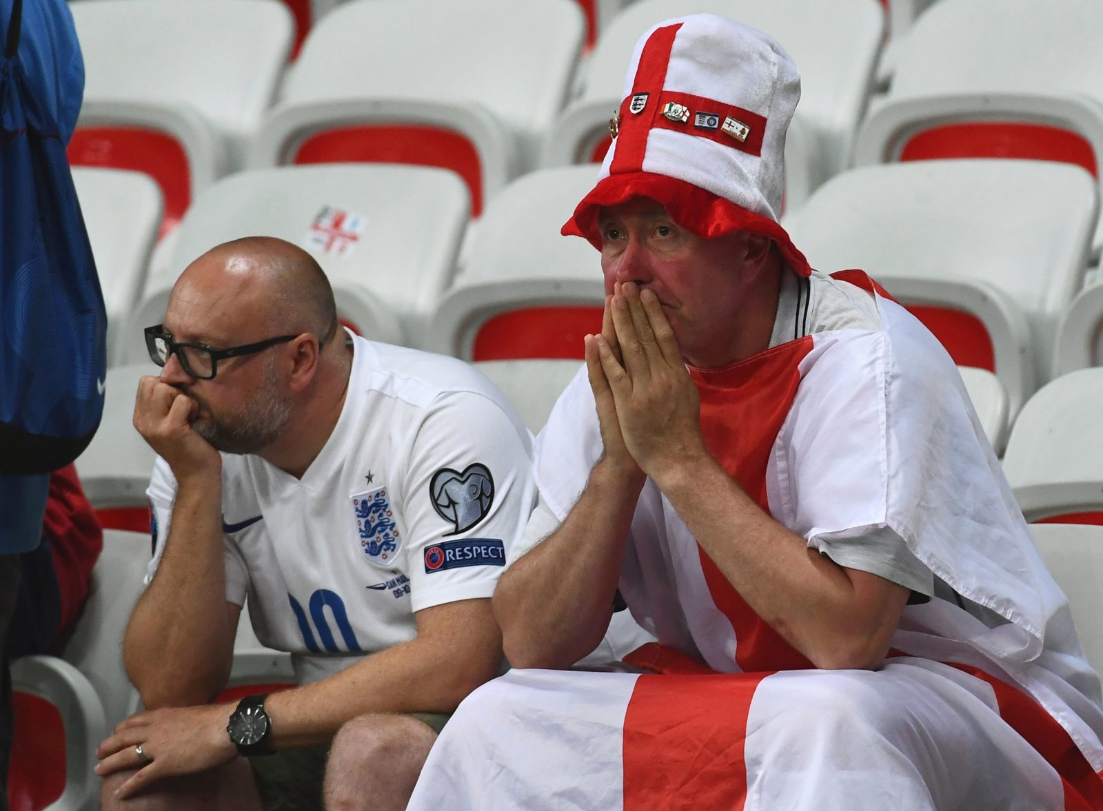 England supporters react after the Euro 2016 round of 16 football match between England and Iceland at the Allianz Riviera stadium in Nice on June 27, 2016. / AFP / ANNE-CHRISTINE POUJOULAT (Photo credit should read ANNE-CHRISTINE POUJOULAT/AFP/Getty Images)