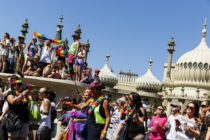BRIGHTON, ENGLAND - AUGUST 06: People line the streets to watch the Brighton Pride Parade on August 6, 2016 in Brighton, England. (Photo by Tristan Fewings/Getty Images)