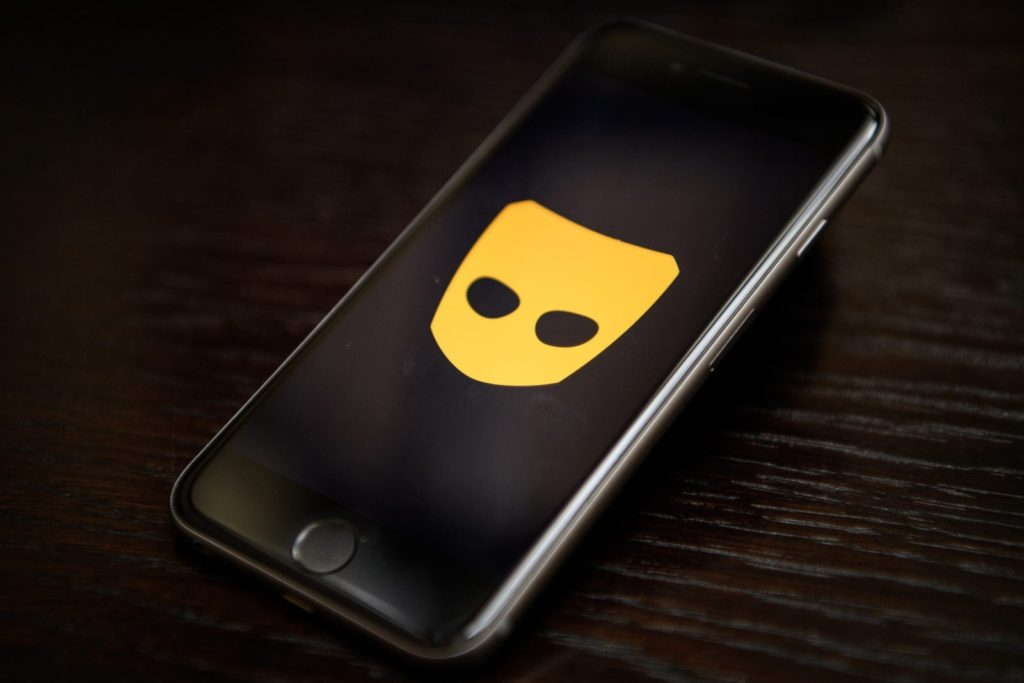 The logo of gay hook-up app Grindr is displayed on a phone