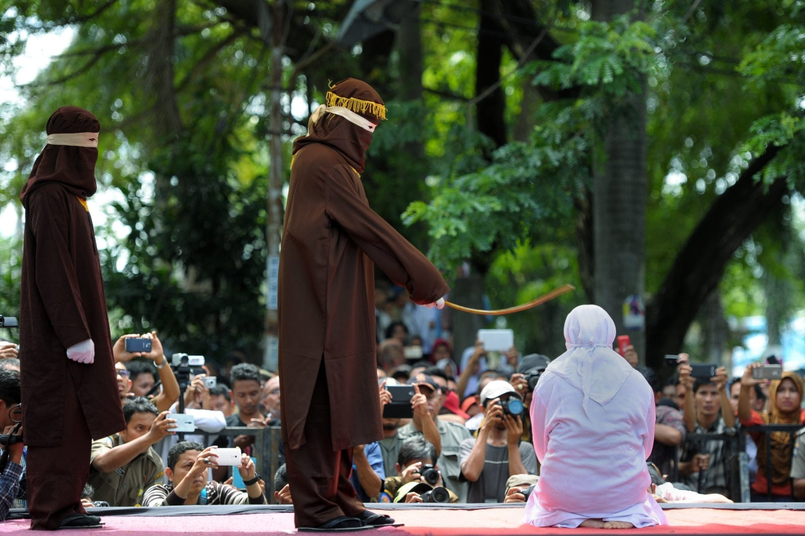 A woman in Aceh is caned 100 times for having sex outside marriage (CHAIDEER MAHYUDDIN/AFP/Getty)