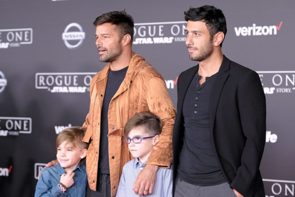 """HOLLYWOOD, CA - DECEMBER 10: Musician Ricky Martin and Jwan Yosef (top L-R) and Valentino Martin and Matteo Martin attend the premiere of Walt Disney Pictures and Lucasfilm's """"Rogue One: A Star Wars Story"""" at the Pantages Theatre on December 10, 2016 in Hollywood, California. (Photo by Frazer Harrison/Getty Images)"""