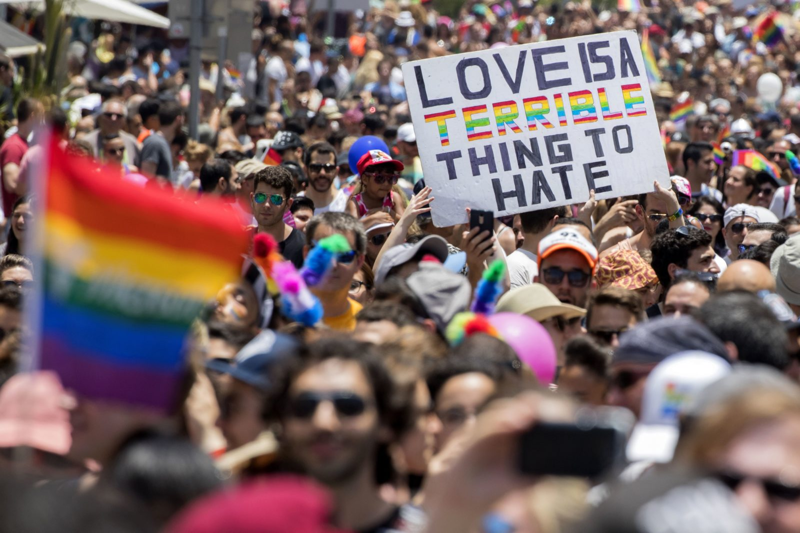 TOPSHOT - Participants take part in the annual Gay Pride parade in the Israeli city of Tel Aviv, on June 9, 2017. Tens of thousands of revellers from Israel and abroad packed the streets of Tel Aviv for the city's annual Gay Pride march, billed as the Middle East's biggest. / AFP PHOTO / JACK GUEZ (Photo credit should read JACK GUEZ/AFP/Getty Images)