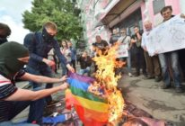 Far-right activists burn the LGBT flag during the official opening of Kyiv Pride 2017