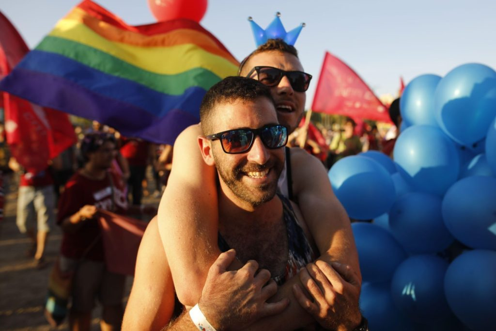 Israelis take part in the first annual Gay Pride parade in the southern Israeli city of Beersheba, on June 22, 2017. Hundreds of Israelis march in Beershebas first gay pride after the head of the southern police district approved plans for the event. / AFP PHOTO / MENAHEM KAHANA (Photo credit should read MENAHEM KAHANA/AFP/Getty Images)