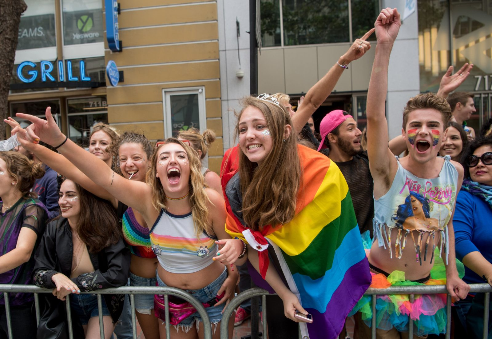 Ciara Hall (L) cheers with friends during the San Francisco Pride parade in San Francisco, California on Sunday, June, 25, 2017. / AFP PHOTO / Josh Edelson (Photo credit should read JOSH EDELSON/AFP/Getty Images)