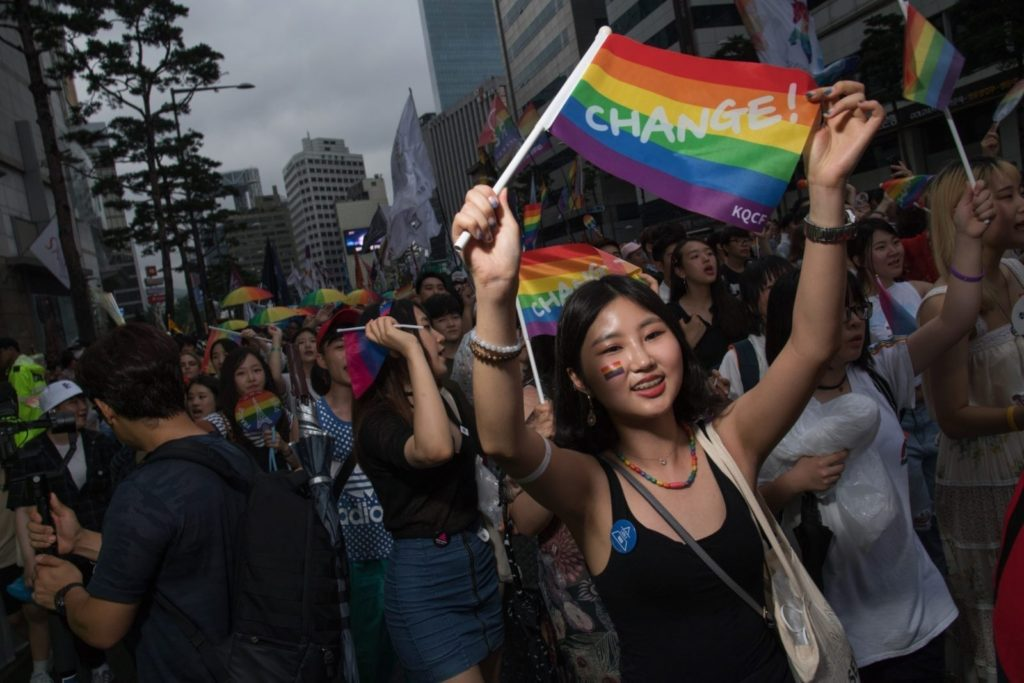 Participants march along a street during a 'Gay Pride' march in Seoul on July 15, 2017. Thousands of people celebrated gay rights with song, dance and a march in Seoul on July 15, amid rain and boisterous protests by conservative Christians. Religious South Koreans have been a loud fixture at the annual parade for years, holding a rival anti-homosexuality rally while trying to physically block the march. / AFP PHOTO / Ed JONES (Photo credit should read ED JONES/AFP/Getty Images)