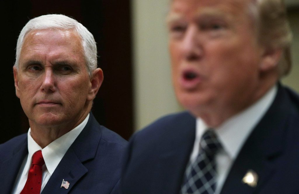 WASHINGTON, DC - JULY 18: U.S. Vice President Mike Pence listens as President Donald Trump speaks to members of the media during a lunch with armed service members at the Roosevelt Room of the White House July 18, 2017 in Washington, DC. President Trump took questions from the press and discussed the status of the healthcare legislation. (Photo by Alex Wong/Getty Images)