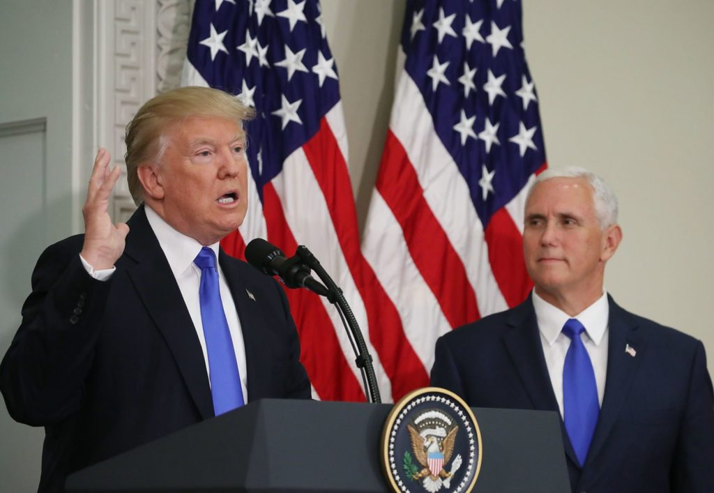 WASHINGTON, DC - JULY 19: U.S. President Donald Trump speaks while flanked by US Vice President Mike Pence during the first meeting of the Presidential Advisory Commission on Election Integrity in the Eisenhower Executive Office Building, on July 19, 2017 in Washington, DC. (Photo by Mark Wilson/Getty Images)